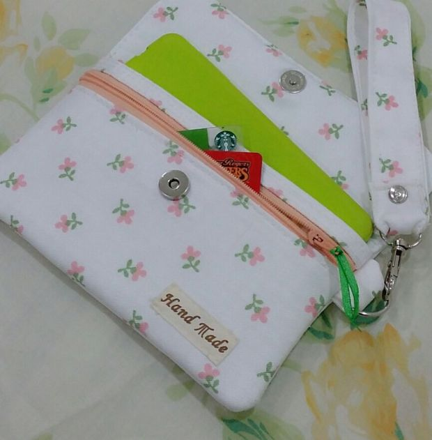 Flower patterned pouch with phone and cards